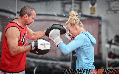 Boxer Holly Holm working with Coach Mike Winkeljohn