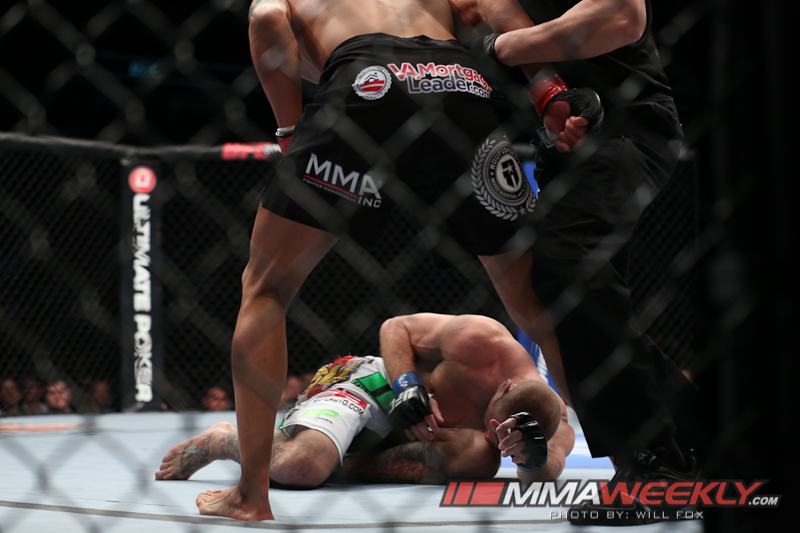 Chicago, IL - Jan 26, 2013:  Anthony Pettis (Black trunks) and D