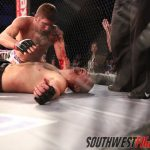 In a brawl, Ryan Thomas uses a flying armbar set up to secure a triangle choke.