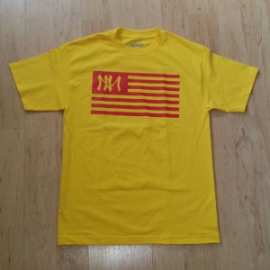 "One of the more iconic designs for the Zia Wear clothing line, the Spanish royal colors of Red and Yellow highlight the ""NM"" logo depicted within the outlines of the flag.  http://www.ziawear.bigcartel.com/"