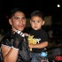 osh Torres holds his son after defeating Francisco Lira.  PHOTO Credit: Bryant Muncy/SWFight.com